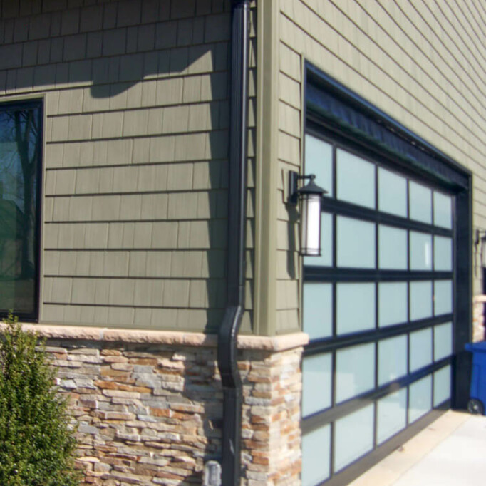 Corner of garage with stone and vinyl siding
